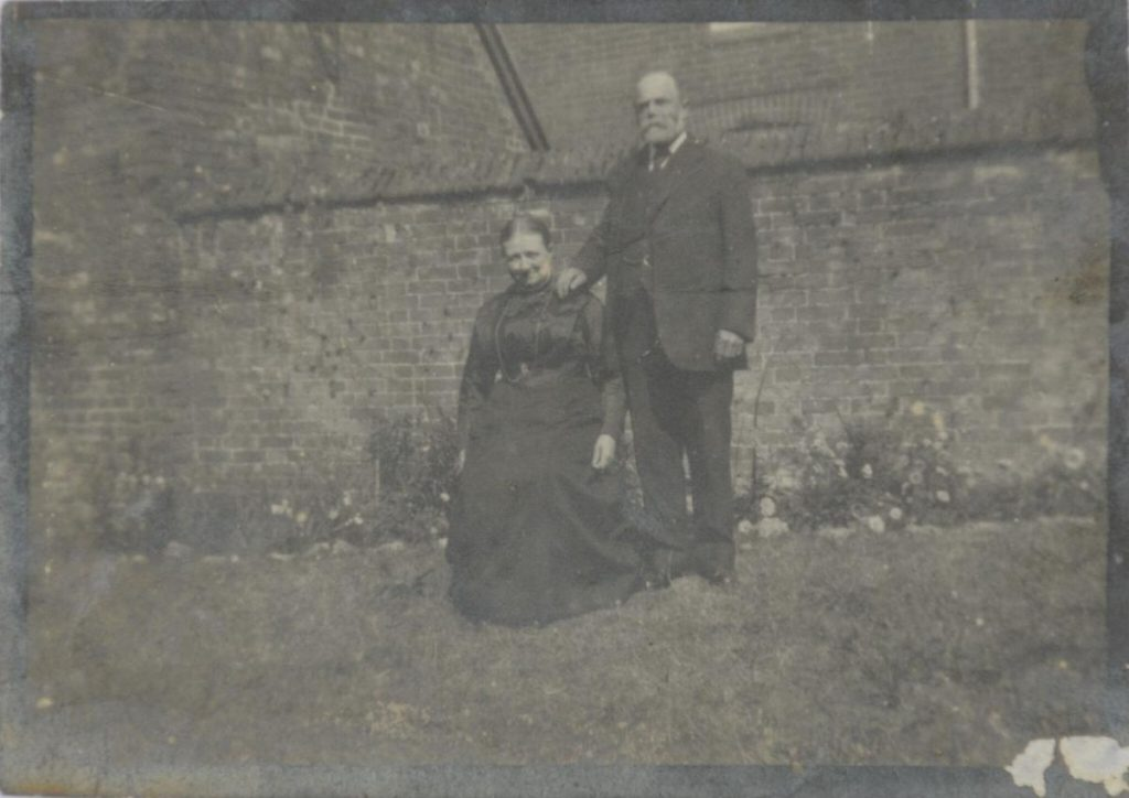 Blacksmith and postmaster George Henry Jones and wife Eliza in the garden at Number 78